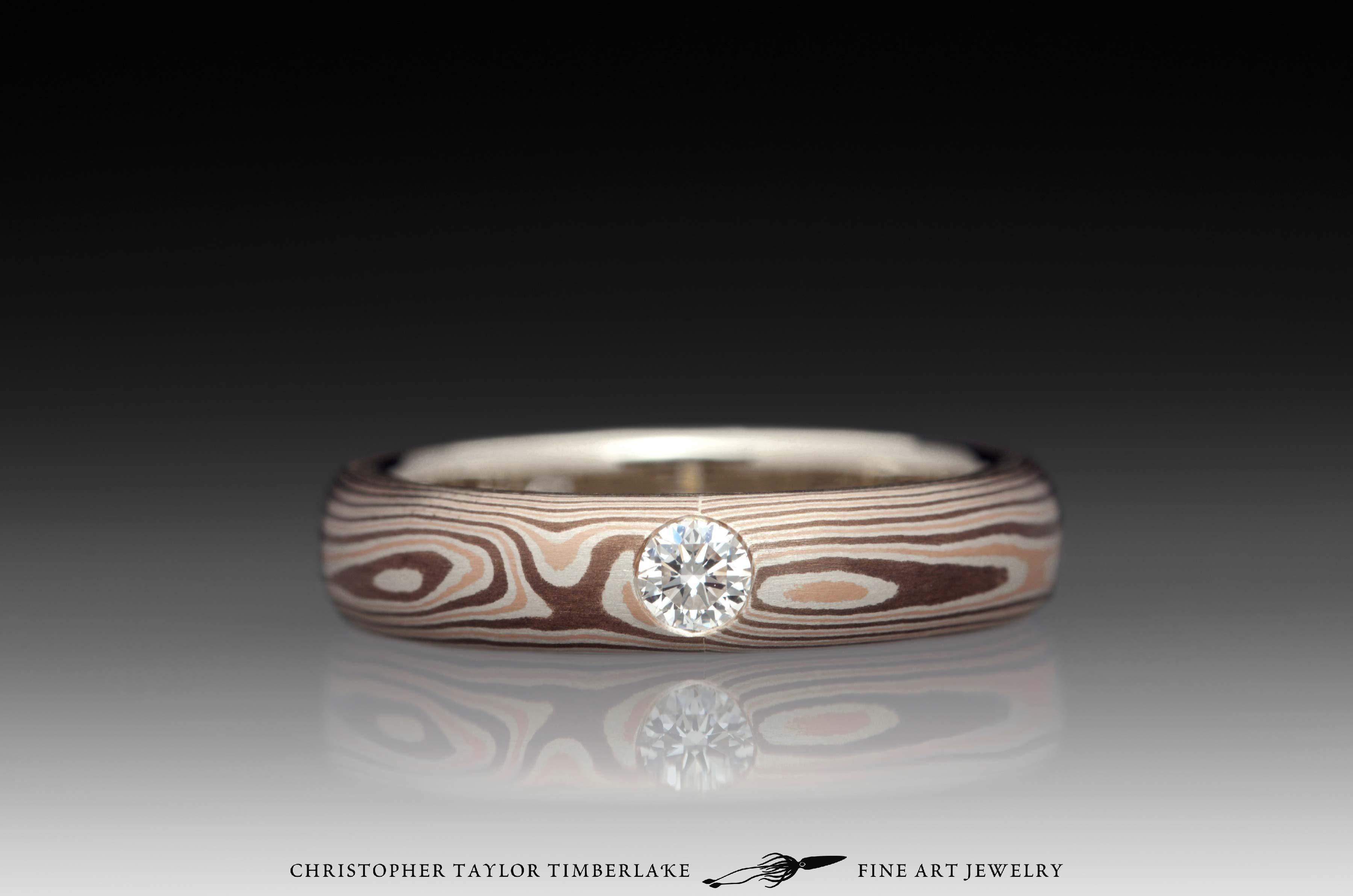 Mokumé-Mokume-Gane-Ring-(M81)-14K-rose-gold,-sterling-silver-with-palladium,-shakudo-2k,-14K-white-gold-inner-band,-domed,-flush-set-rd-2.9mm-diamond,-woodgrain,-4mm-1