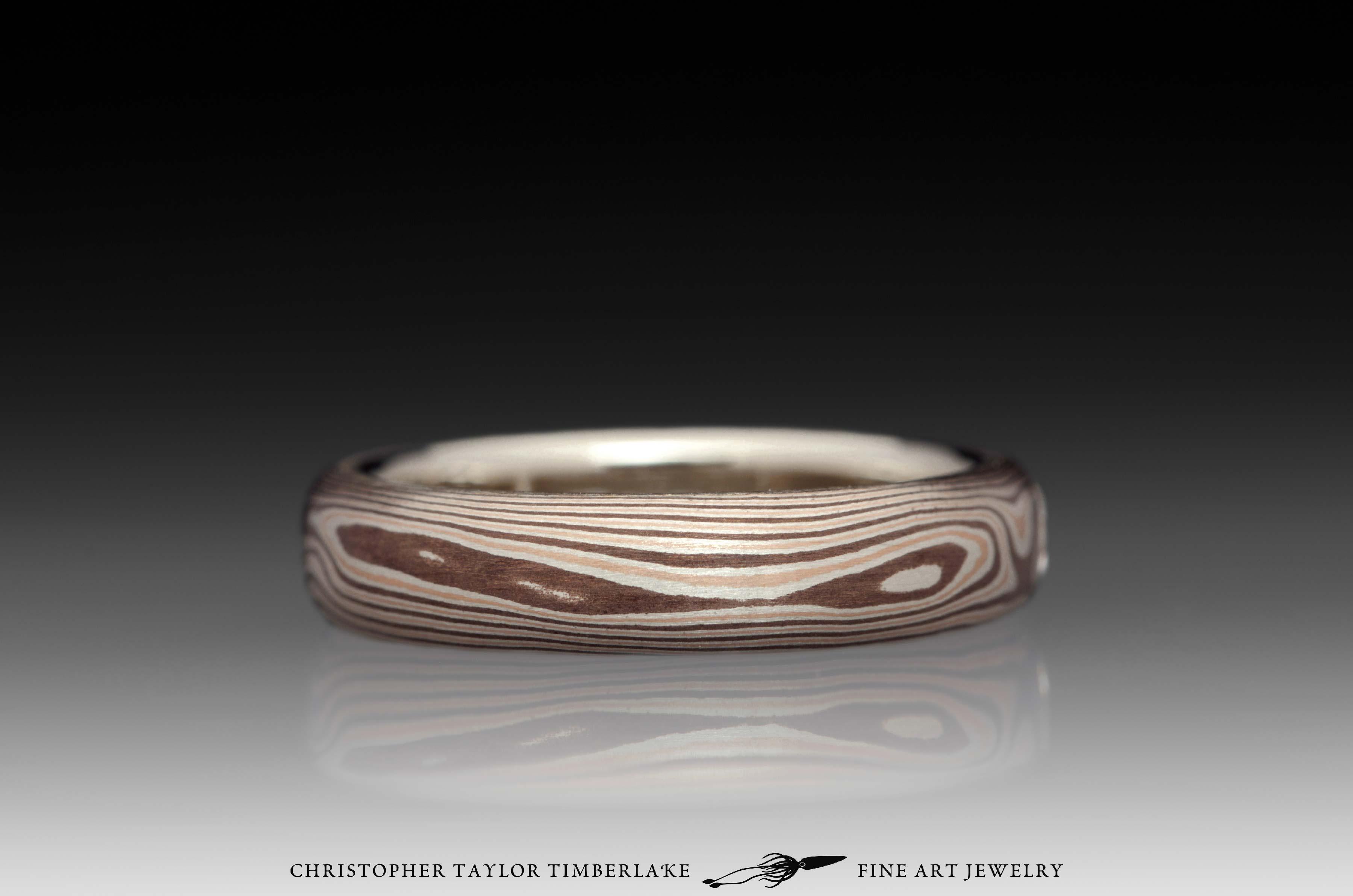 Mokumé-Mokume-Gane-Ring-(M81)-14K-rose-gold,-sterling-silver-with-palladium,-shakudo-2k,-14K-white-gold-inner-band,-domed,-flush-set-rd-2.9mm-diamond,-woodgrain,-4mm-2