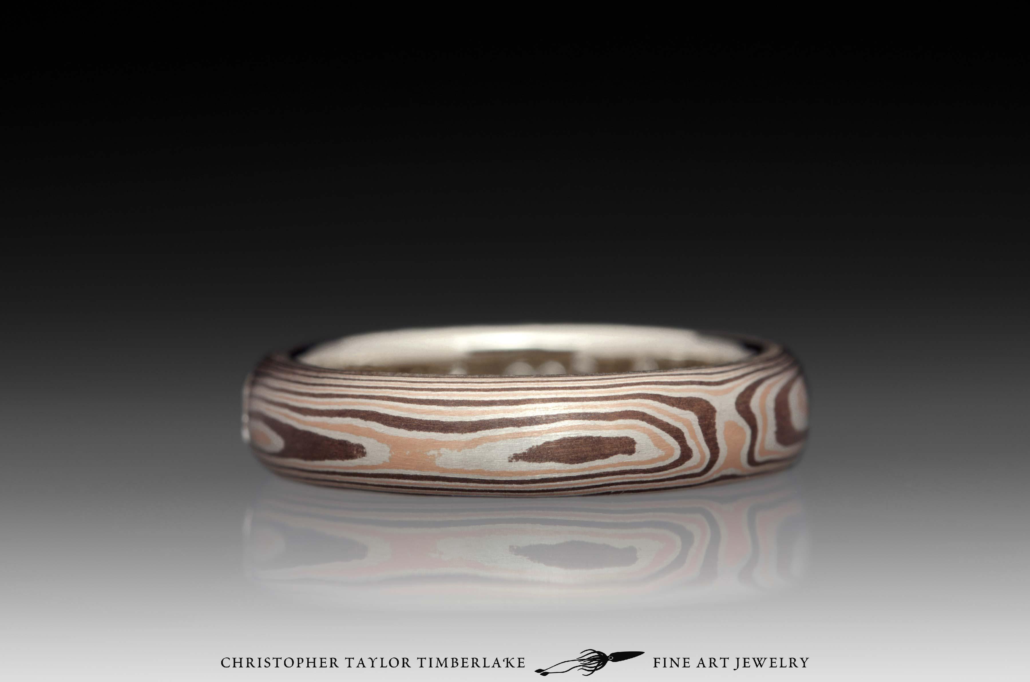 Mokumé-Mokume-Gane-Ring-(M81)-14K-rose-gold,-sterling-silver-with-palladium,-shakudo-2k,-14K-white-gold-inner-band,-domed,-flush-set-rd-2.9mm-diamond,-woodgrain,-4mm-4