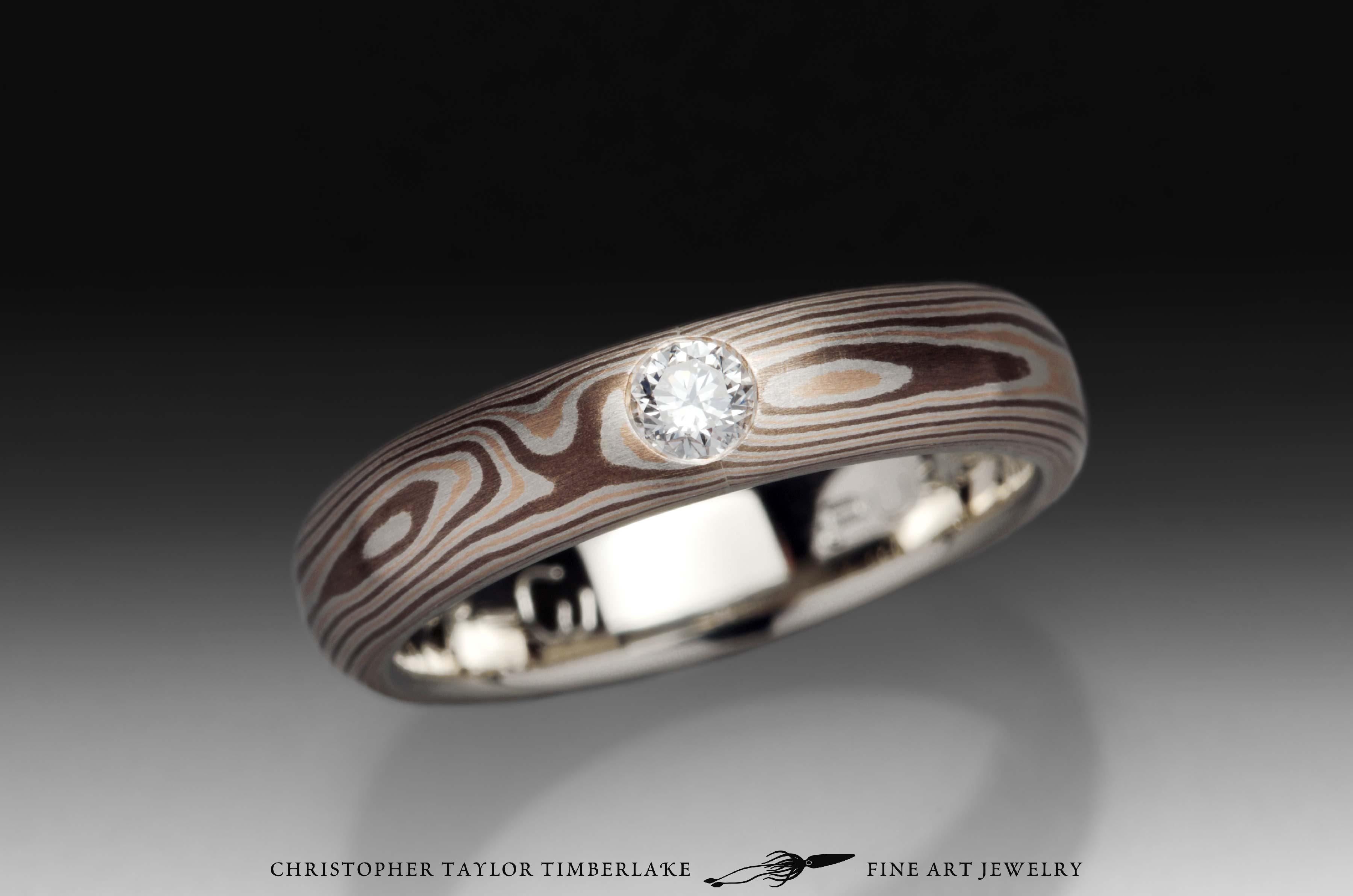 Mokumé-Mokume-Gane-Ring-(M81)-14K-rose-gold,-sterling-silver-with-palladium,-shakudo-2k,-14K-white-gold-inner-band,-domed,-flush-set-rd-2.9mm-diamond,-woodgrain,-4mm-5
