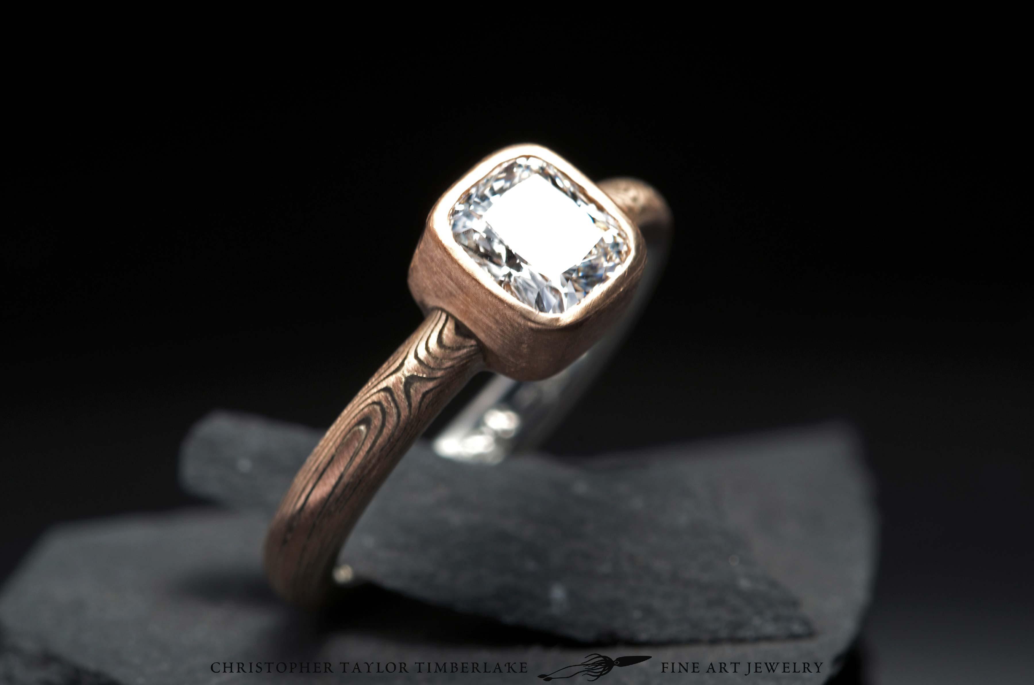 Mokume-(M83b)-14K-(karat)-rose-gold-and-sterling-silver,-0.75CT-cushion-cut-diamond-in-18K-red-bezel,-etched,-woodgrain-2.5mm-6