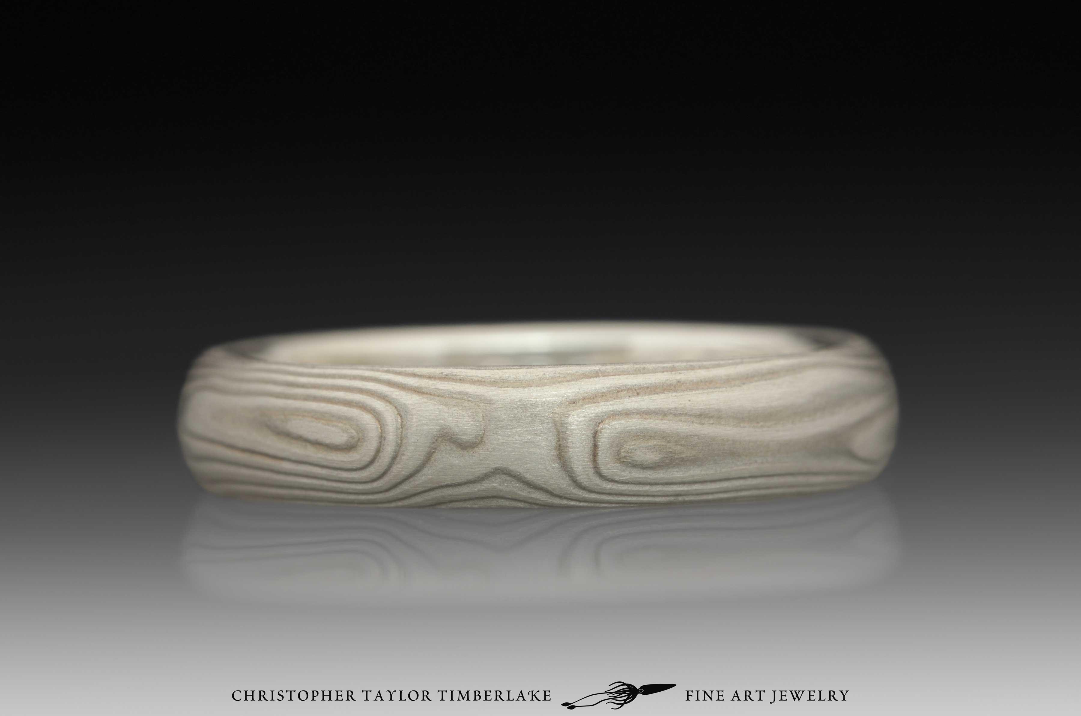 Mokume-Gane-(M70)-sterling-silver,-nickel,-woodgrain,-domed,-etched-4mm,-sterling-silver-inner-band-1