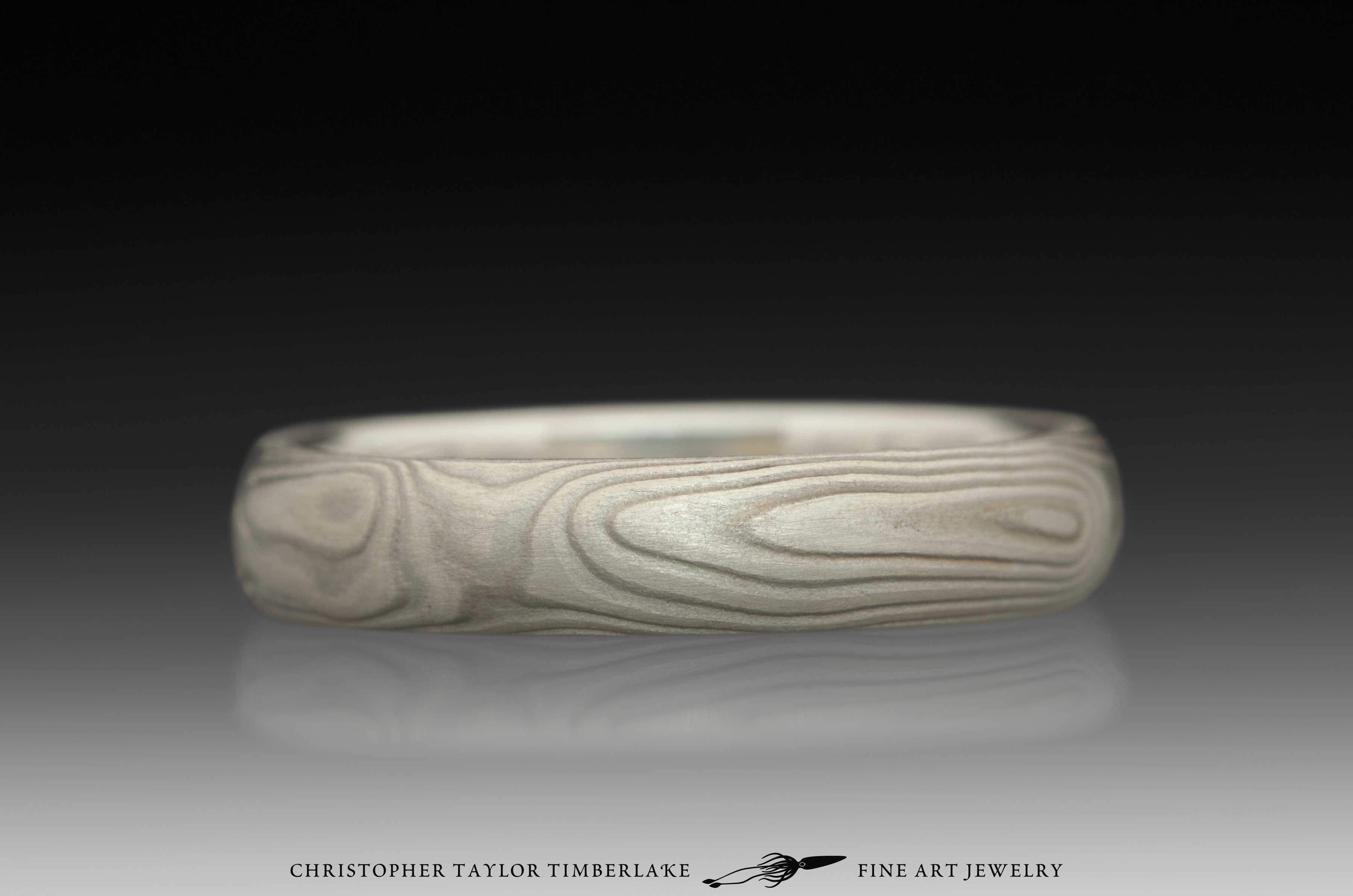 Mokume-Gane-(M70)-sterling-silver,-nickel,-woodgrain,-domed,-etched-4mm,-sterling-silver-inner-band-2