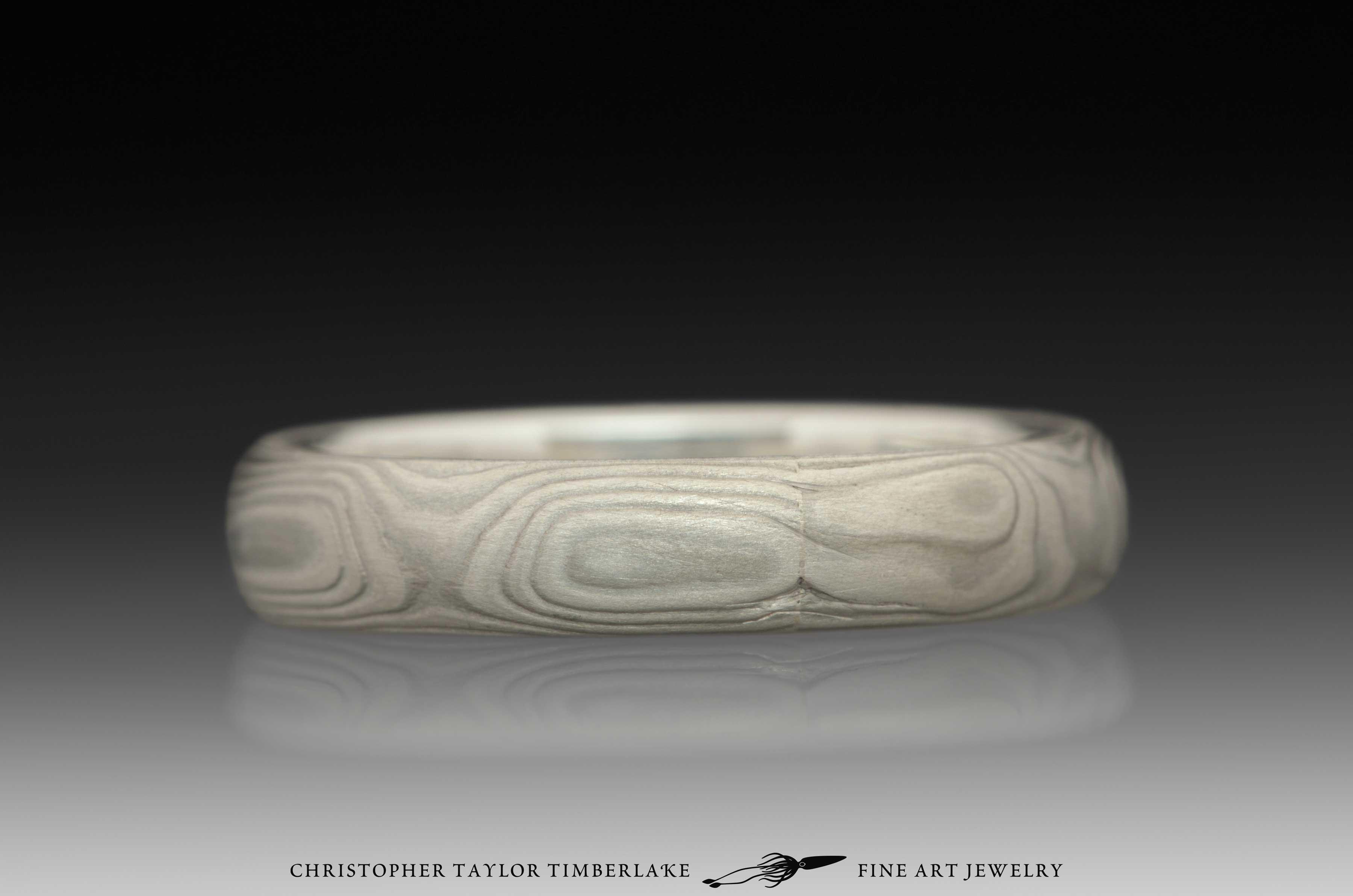 Mokume-Gane-(M70)-sterling-silver,-nickel,-woodgrain,-domed,-etched-4mm,-sterling-silver-inner-band-3