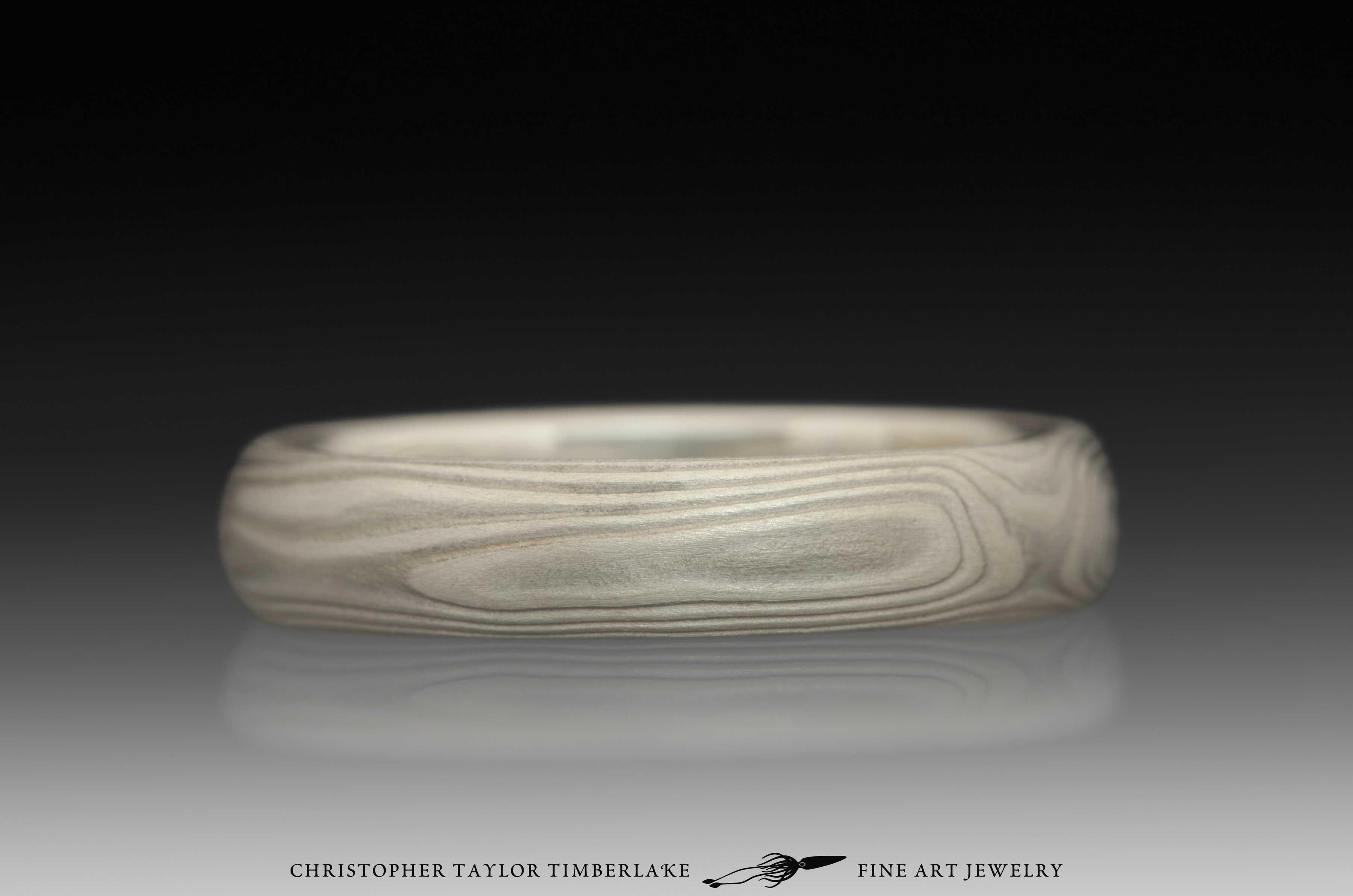 Mokume-Gane-(M70)-sterling-silver,-nickel,-woodgrain,-domed,-etched-4mm,-sterling-silver-inner-band-4