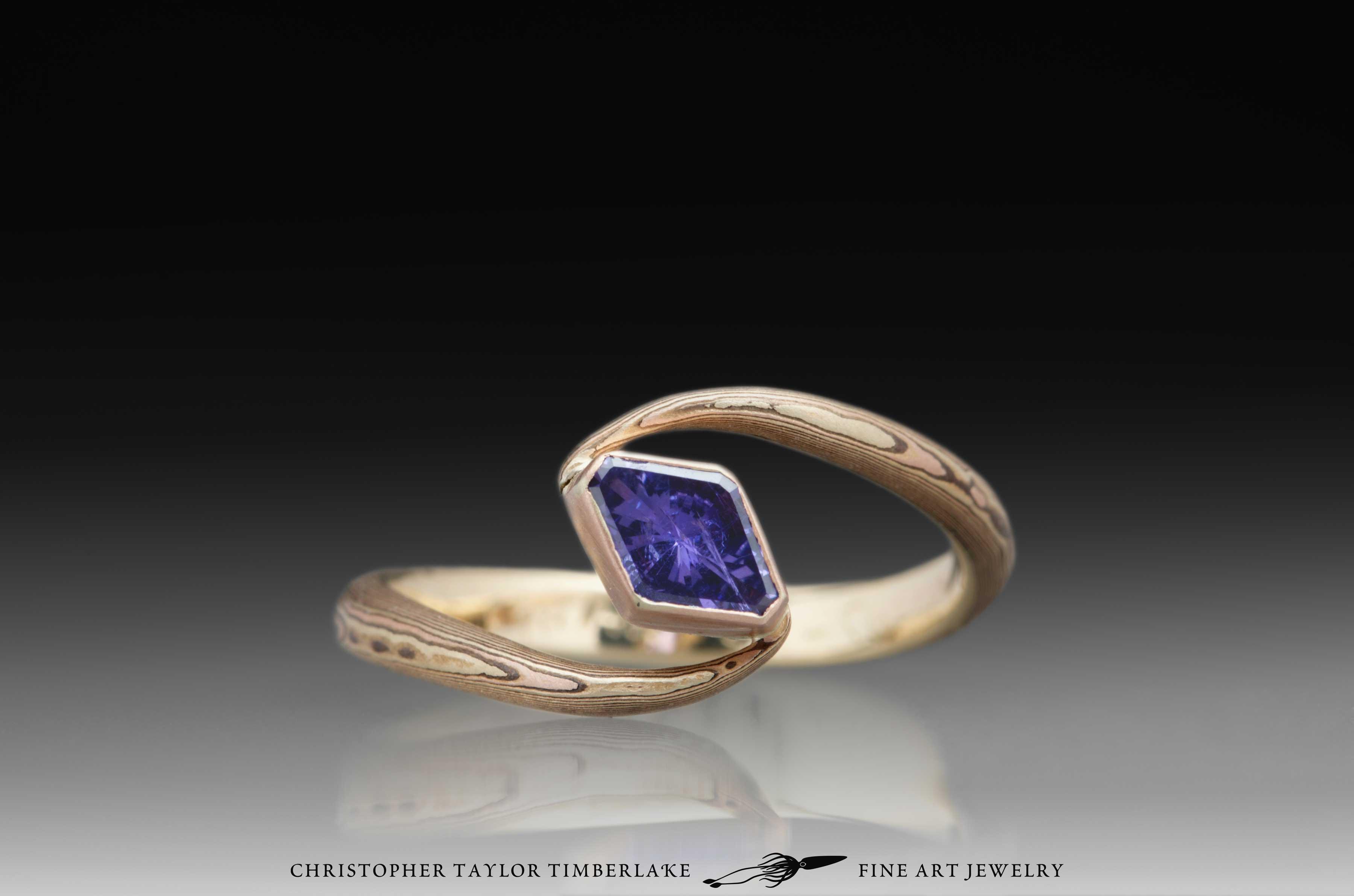 Mokume-Gane-(M101)-14K-Rose-Gold,-14K-Yellow-Gold,-Shakudo-2k,-14K-rose-gold-bezel,-14K-yellow-gold-inner-band,-0.52CT-Lozenge-Umba-Sapphire-(N)-1