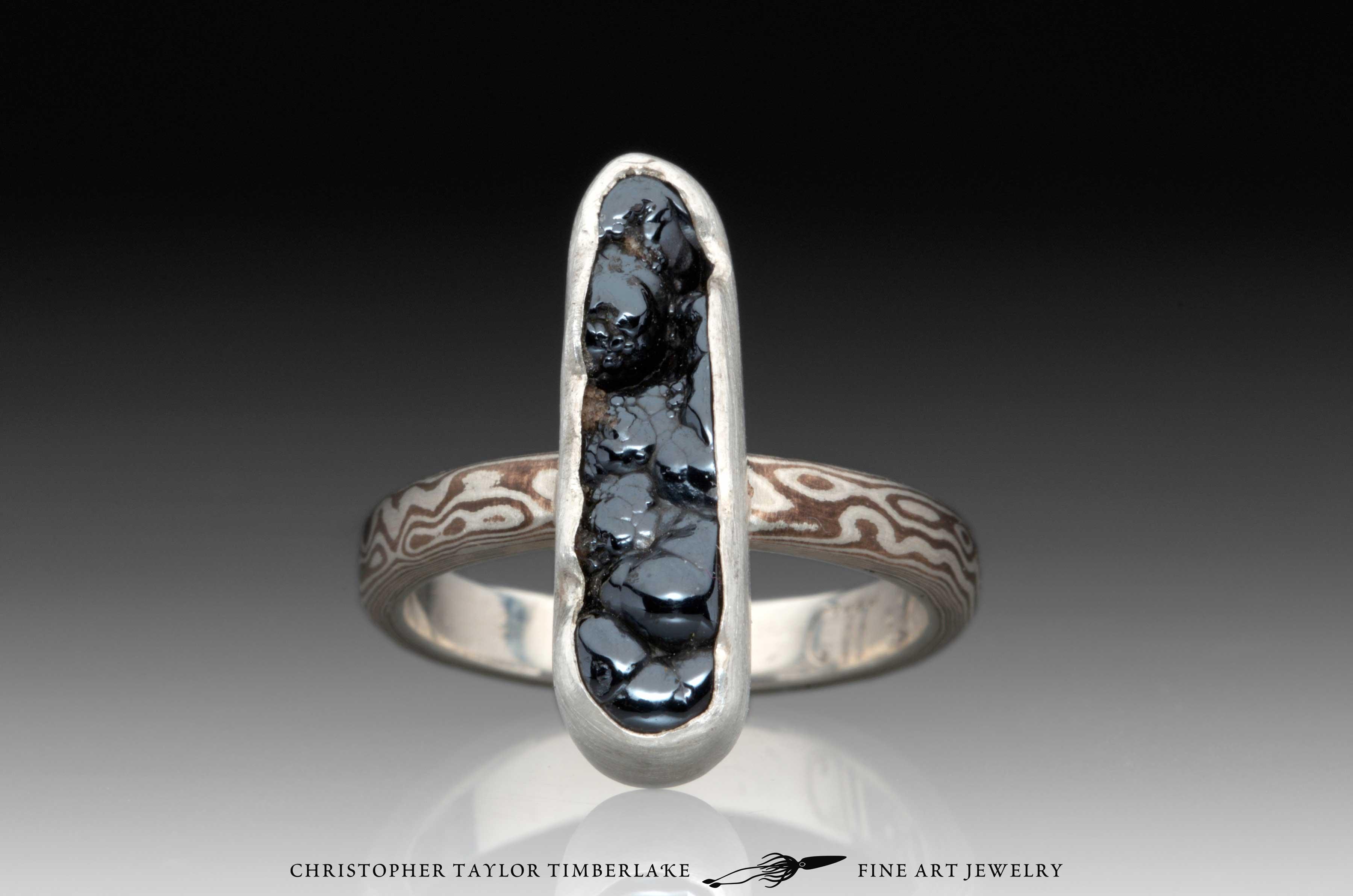Mokume-Gane-(M55)-sterling-silver,-shakudo,–elongated-oval-hematite-cabochon-1