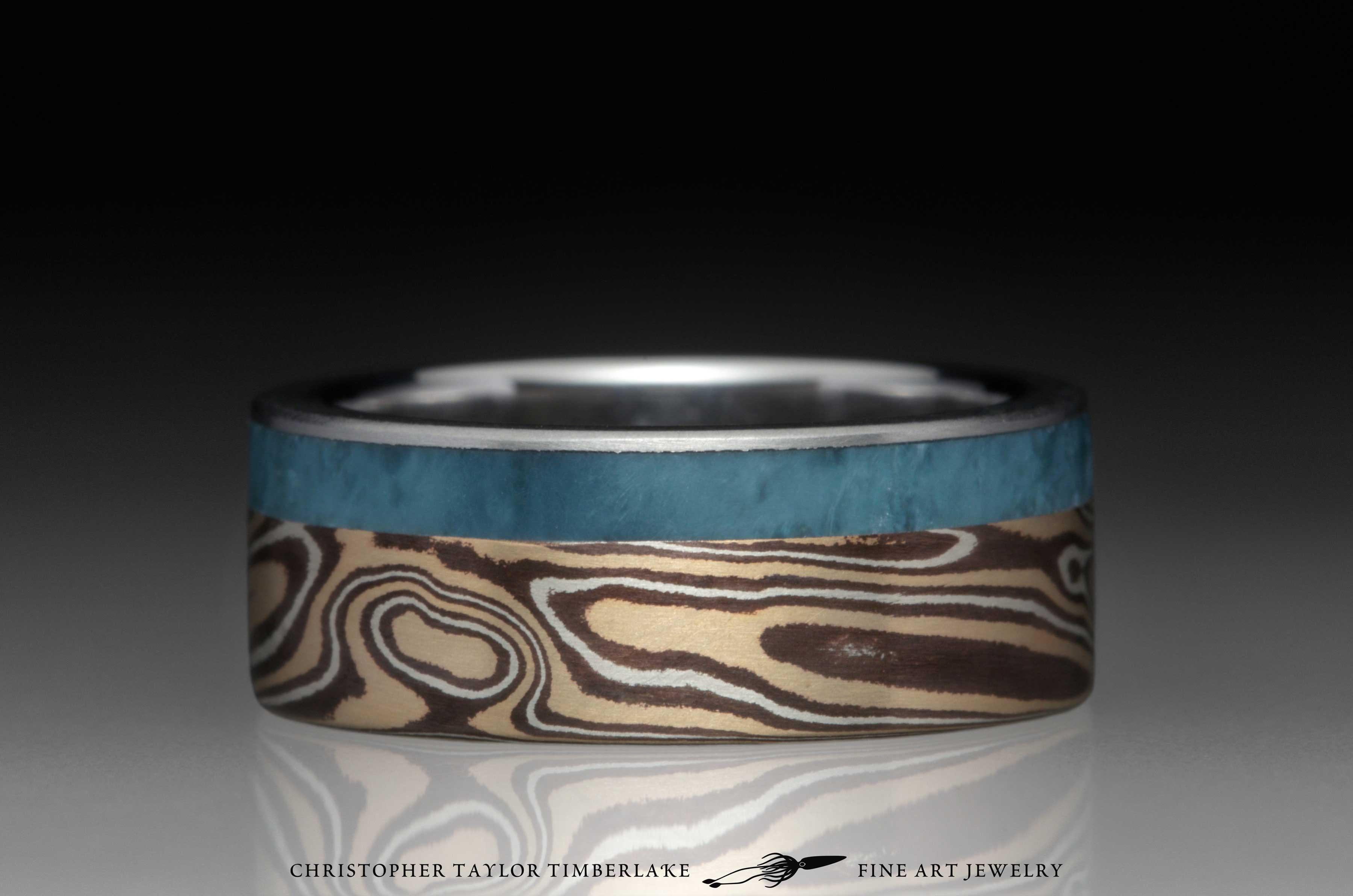 Mokume-Gane-(M119)-14K-yellow-gold,-sterling-silver,-shakudo,-7.4mm-(5-2-.4),-woodgrain,-flat-topped,-stainless-steel-inner-band-1